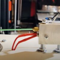 A homemade robot turns plastic bottles into a thread. Video