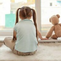 From what age can a child be left alone at home